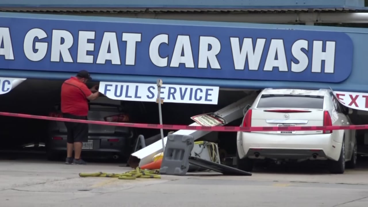 Storms moving through Conroe toppled a car wash canopy and whipped machines around like toys, workers said.