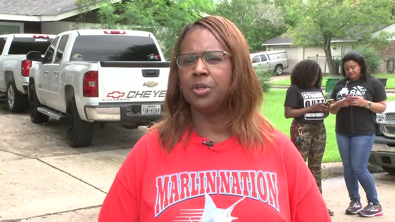Houston Independent School District staff walk around neighborhoods to re-enroll high school dropouts