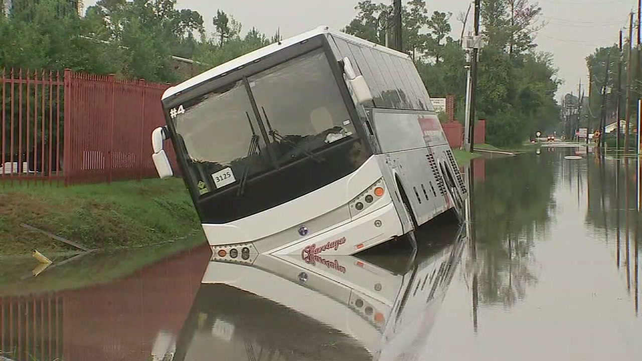 A charter bus carrying 34 people ran off the road and into a flooded ditch in northwest Harris County Saturday afternoon.