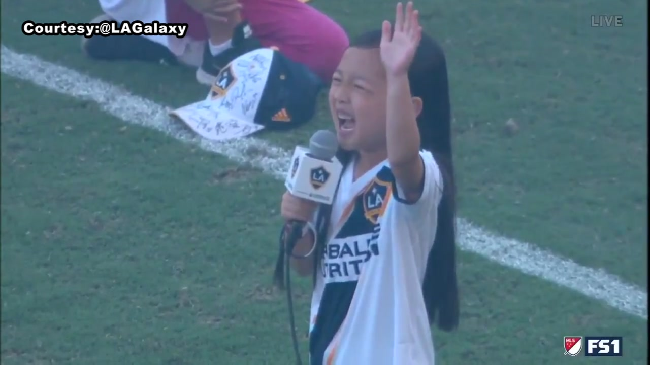 You need to hear this 7-year-old girl sing the national anthem!