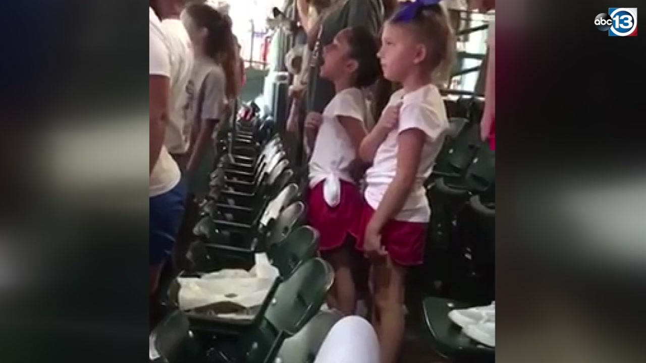 LOUD AND PROUD: Girl sings along with national anthem at Astros game