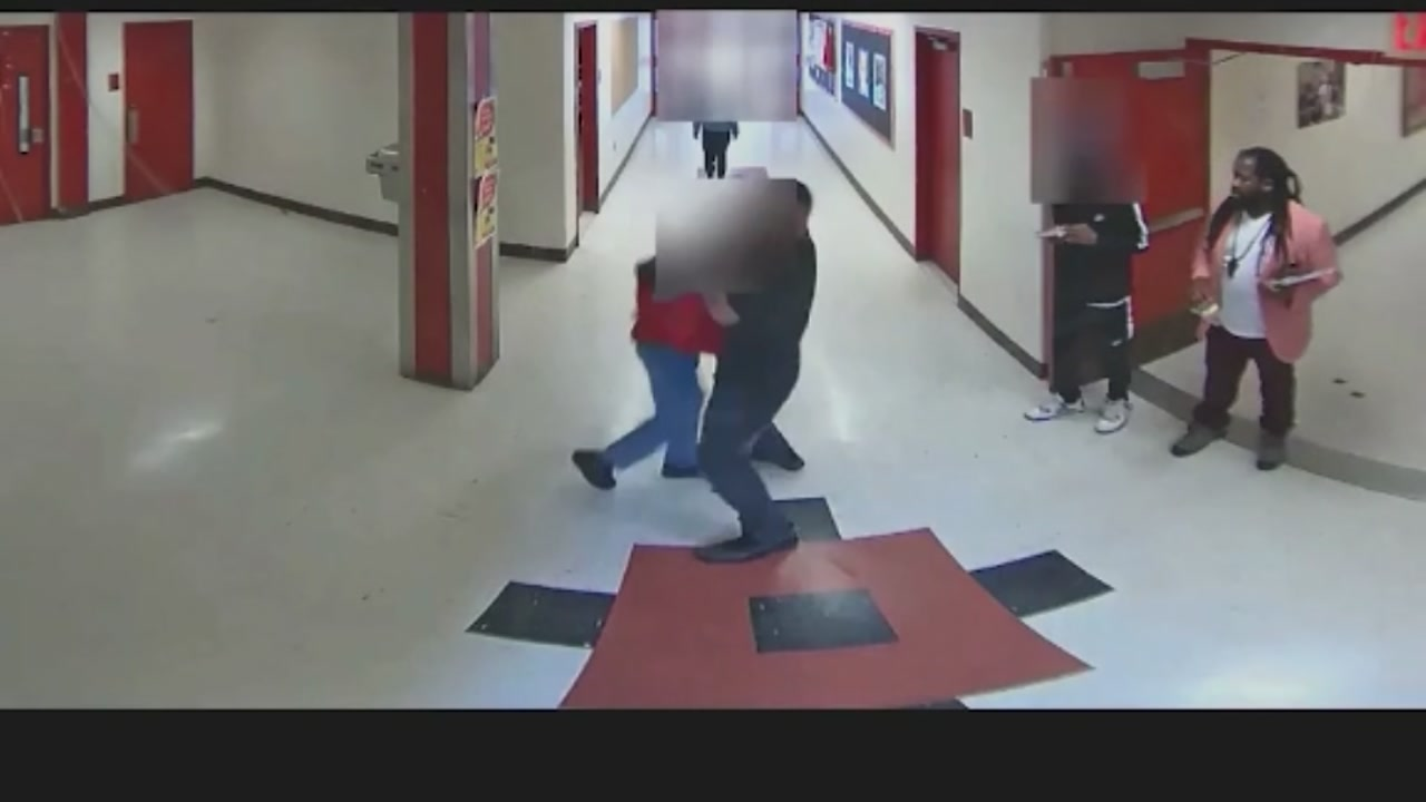 A Connecticut high school employee and a student on camera having a fight.