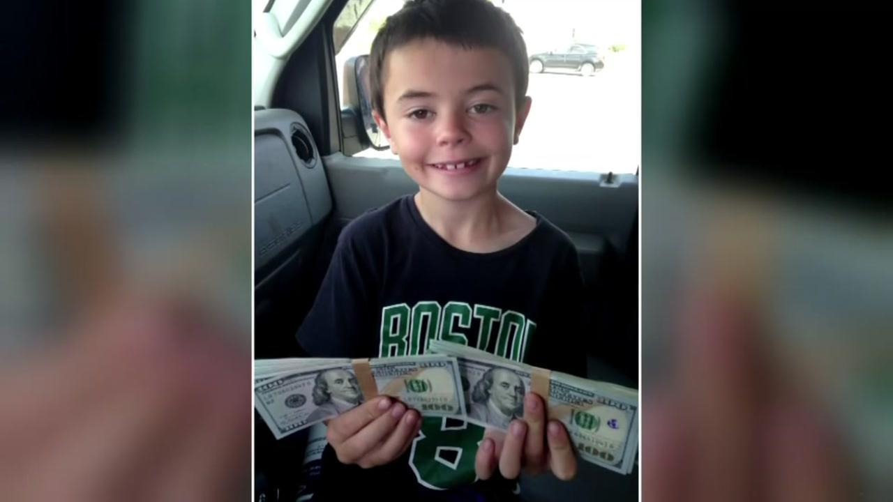 Boy returns $8K he found