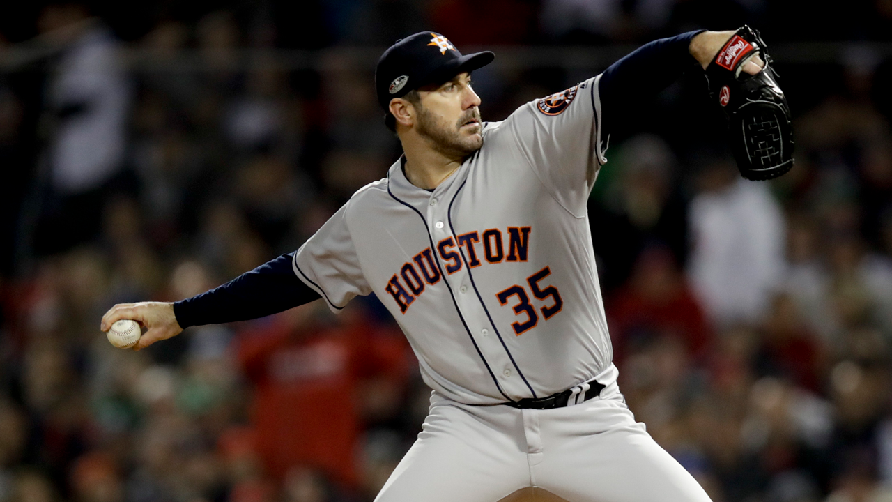 Houston Astros starting pitcher Justin Verlander throws against the Boston Red Sox during the first inning in Game 1 of a baseball American League Championship Series.
