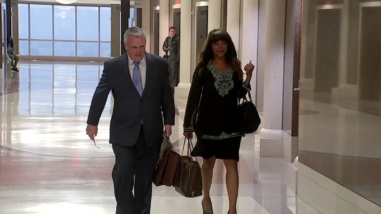 Darian Ward and her attorney walk down a hallway in the Harris County Courthouse before an appearance Oct. 16, 2018.