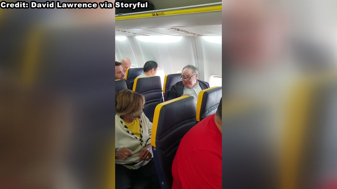 The video, uploaded to social media showed a man hurling racist insults at an elderly black woman sitting in the same row and demanding she move seats