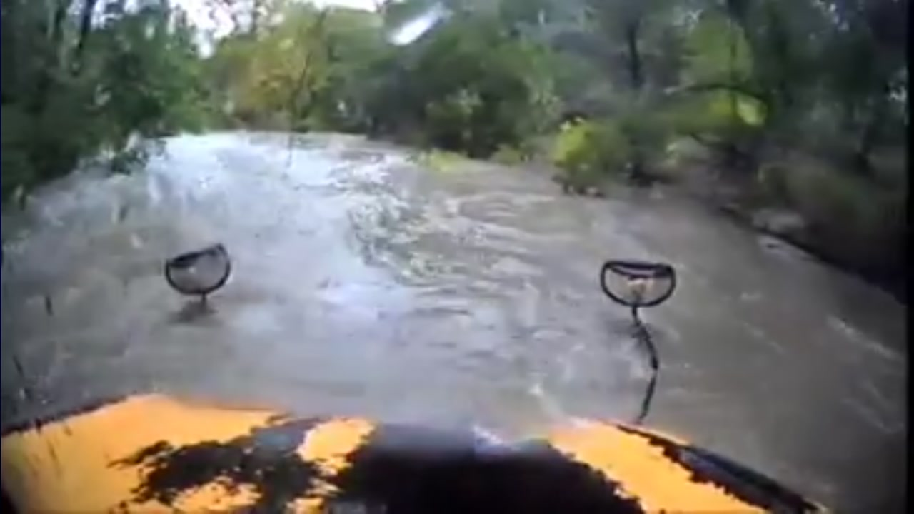 Bus driver attempts to drive through dangerous flood waters