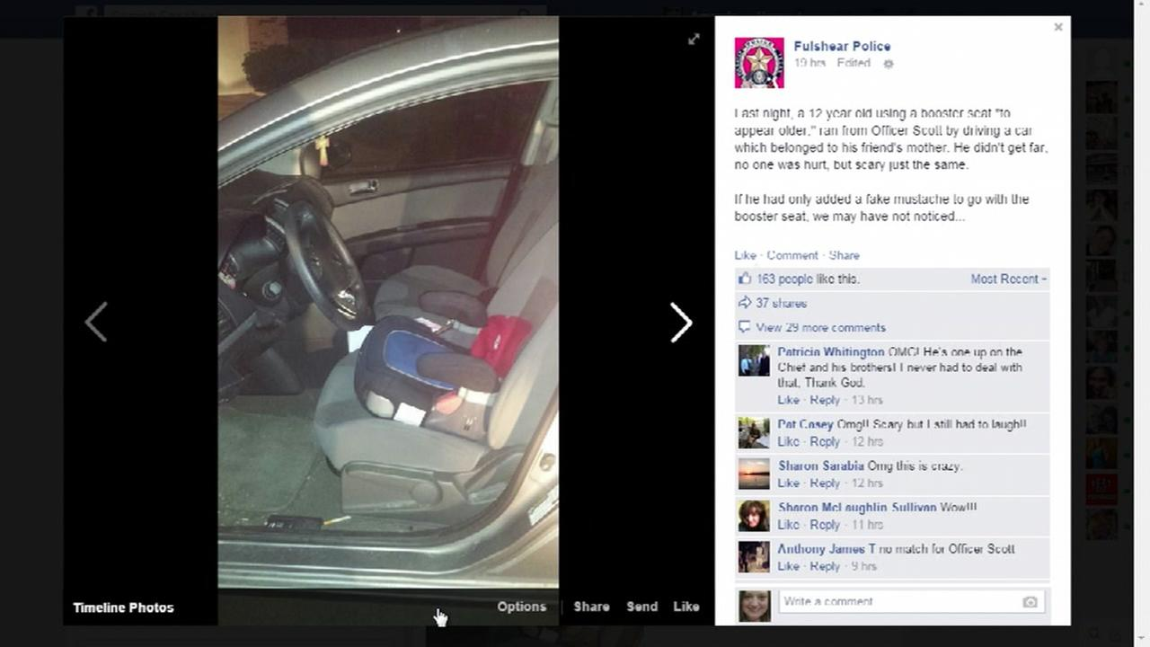 Child drives in booster seat