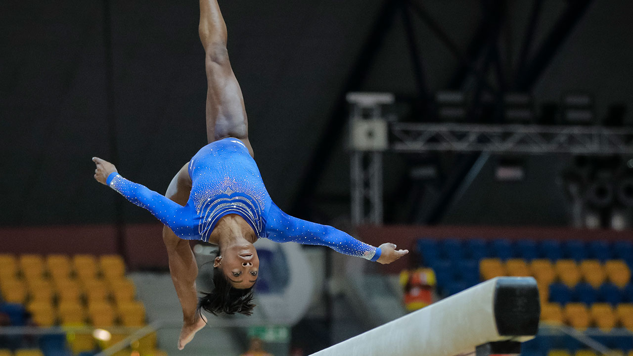 Simone Biles of the U.S. performs on the beam during qualifying sessions for the Gymnastics World Chamionships at the Aspire Dome in Doha, Qatar, Saturday, Oct. 27, 2018