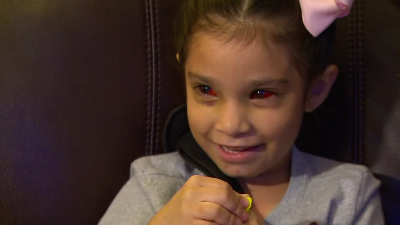 A young girl is recovering from her injuries after she left her pinned under the wheel of a SUV.