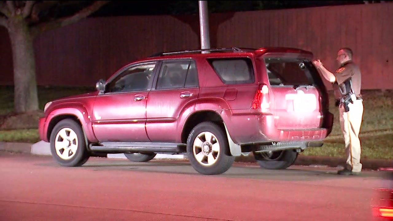 Deputies said the suspect pulled the man out of the SUV and started driving off with the passenger.
