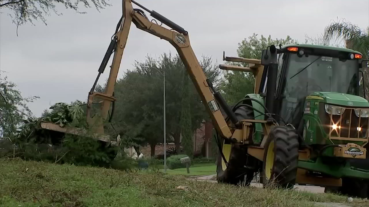 A city of Houston crew mows a lot on the south side of the city.