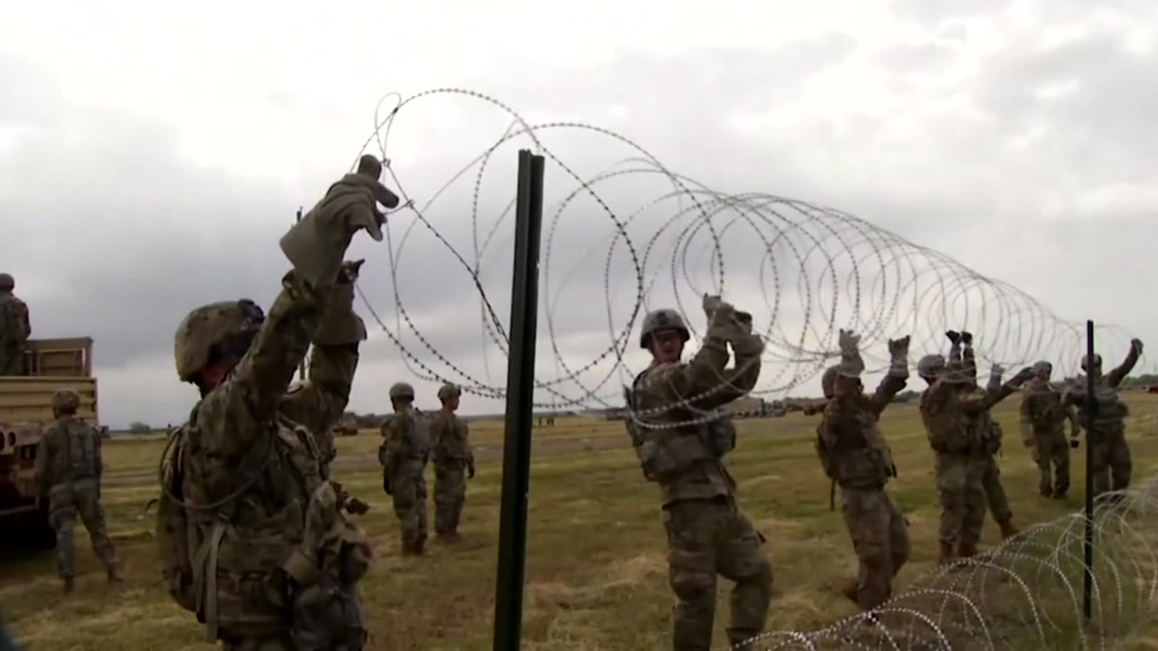 Barbed wire fences have gone up near the U.S.-Mexico border.