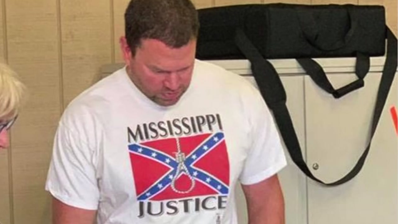 A viral photo shows Clayton Hickley voting in a t-shirt with the confederate flag and a noose on the front