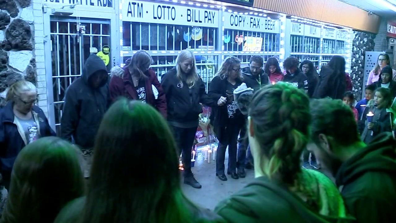 Store clerk murder vigil
