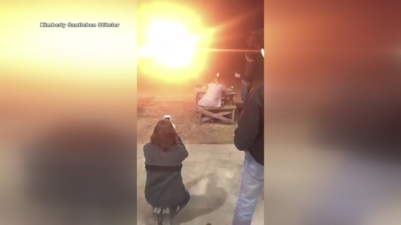 A woman celebrated the end of her divorce by blowing up her wedding dress.