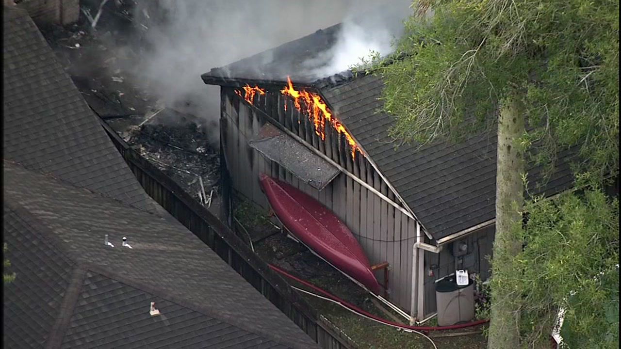 Firefighters are battling a large house fire in a neighborhood south of Pasadena.