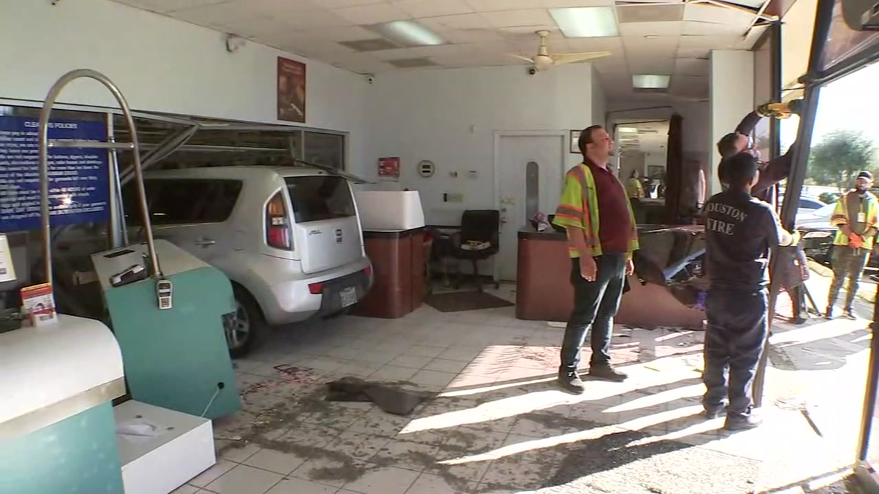 It was a close call for an employee and a customer when a car slammed into a dry cleaners.