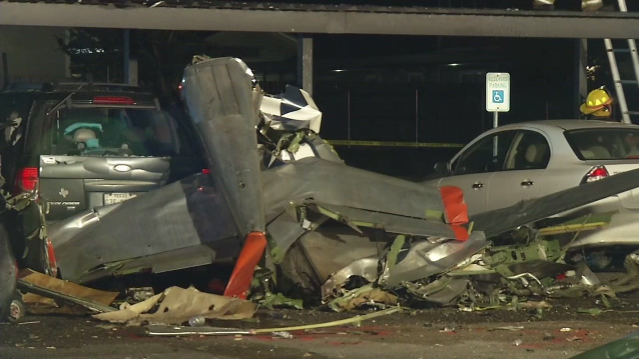 Authorities have confirmed two people are dead after a plane crashed into an apartment complex parking lot.