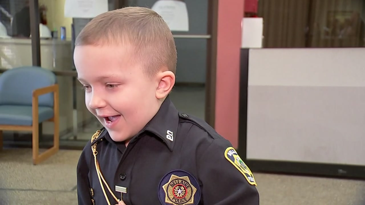 Officers welcome 7-year-old battling cancer to the force