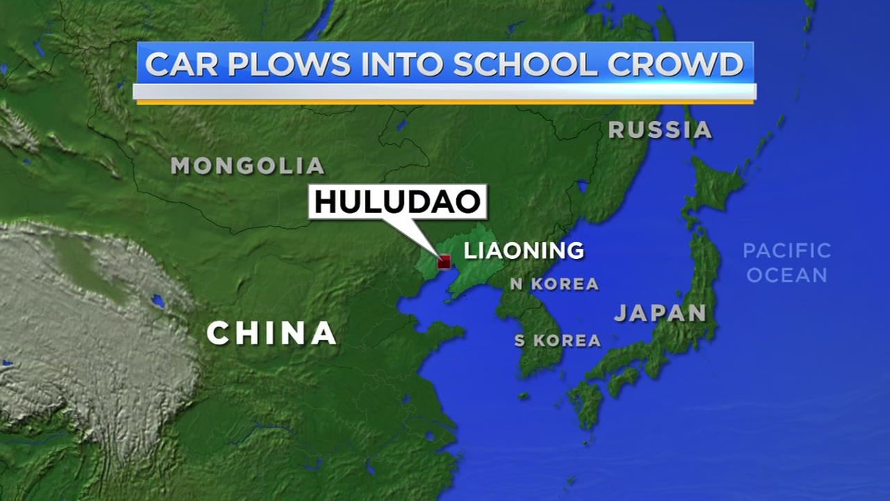 Car strikes crowd at China school, killing 5 and hurting 18