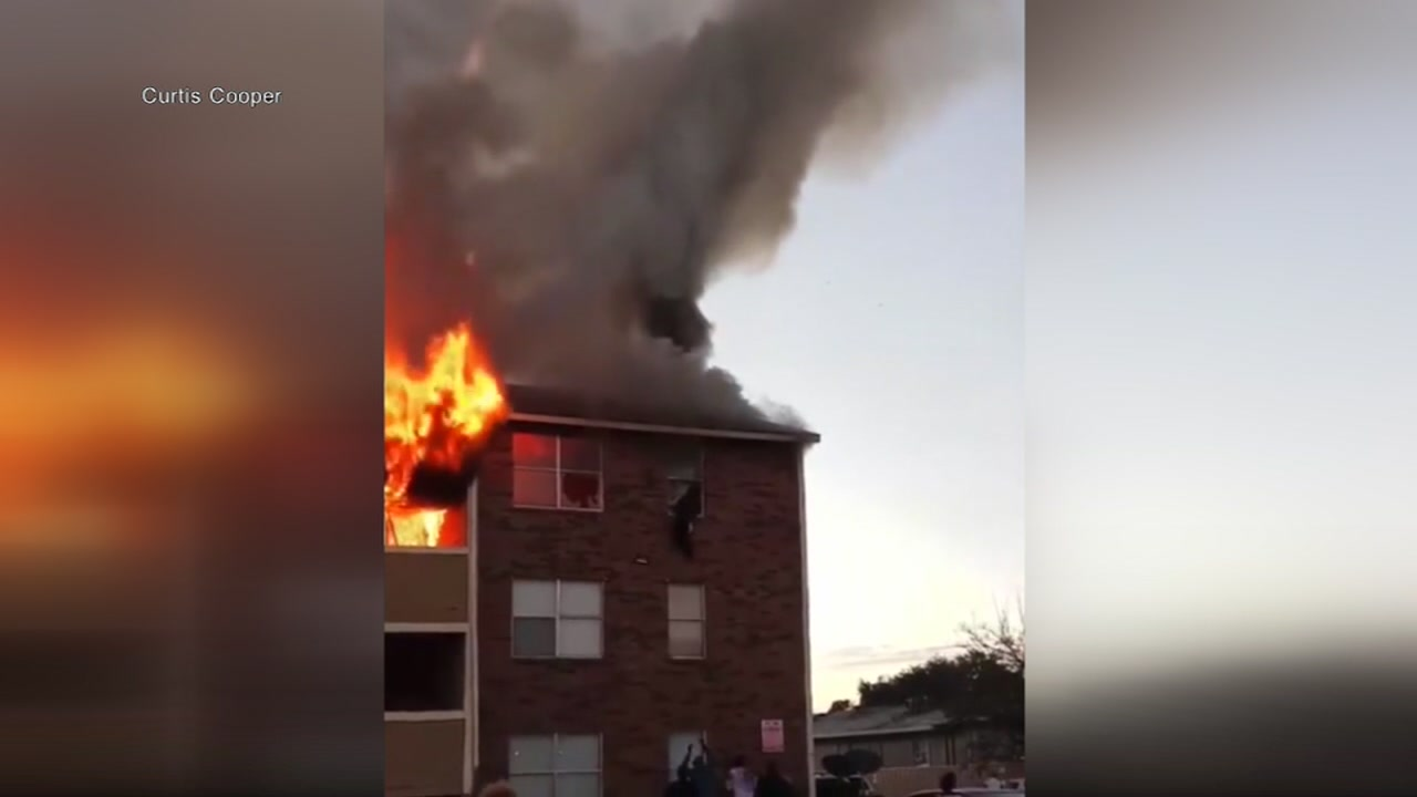 Woman in burning apartment fires drops baby to bystander