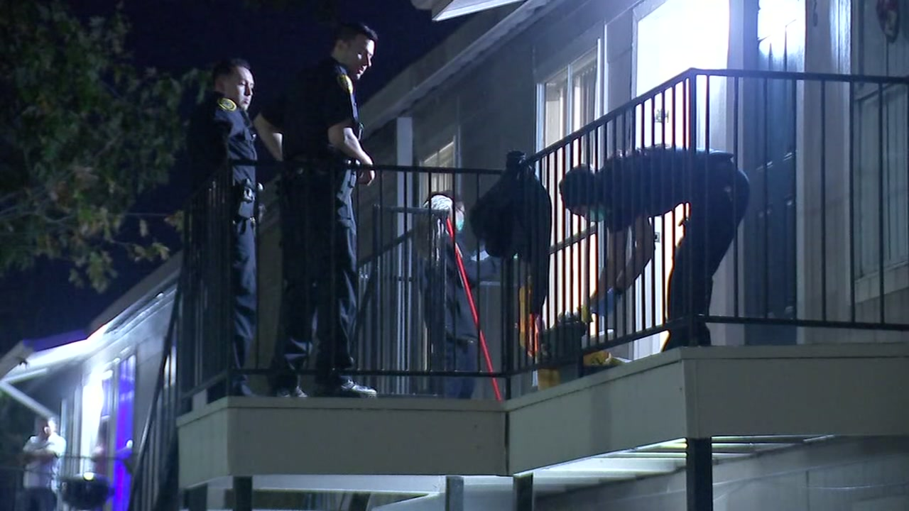 Police say the womans ex-husband shot the boyfriend multiple times at an apartment complex.