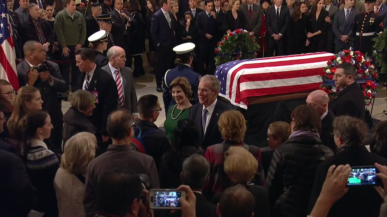 George W. Bush visits his father at the Capitol Rotunda