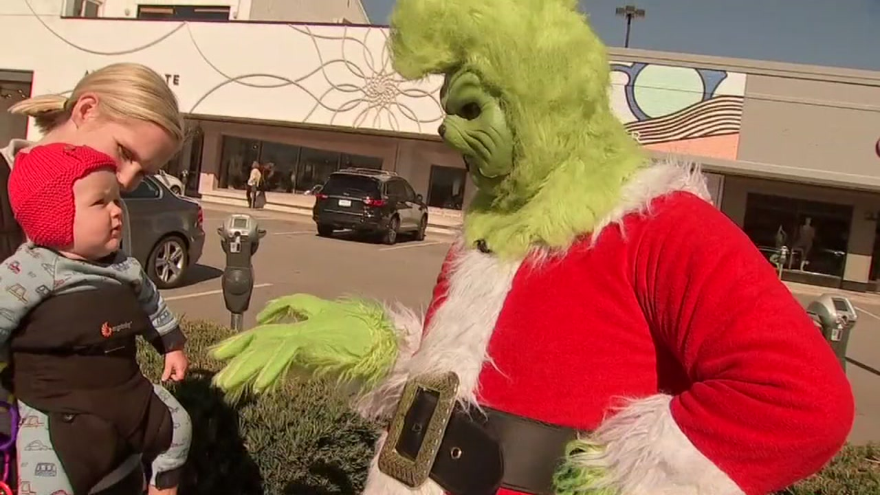 Believe it or not, a Grinch is bringing holiday cheer.