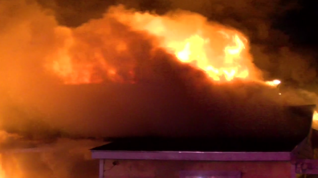 Strong winds made it hard for firefighters to put out the flames at an auto shop.