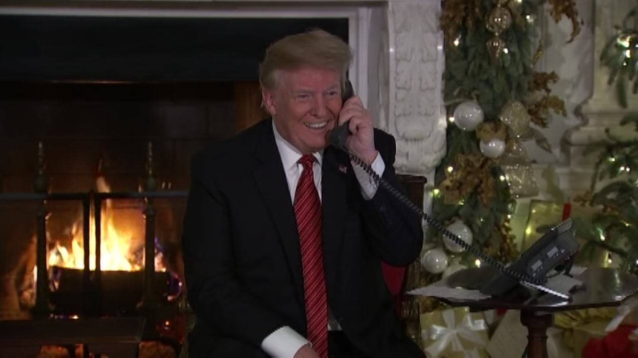 President Donald Trump and First Lady Melania Trump took calls from children anxious to learn of Santas whereabouts.