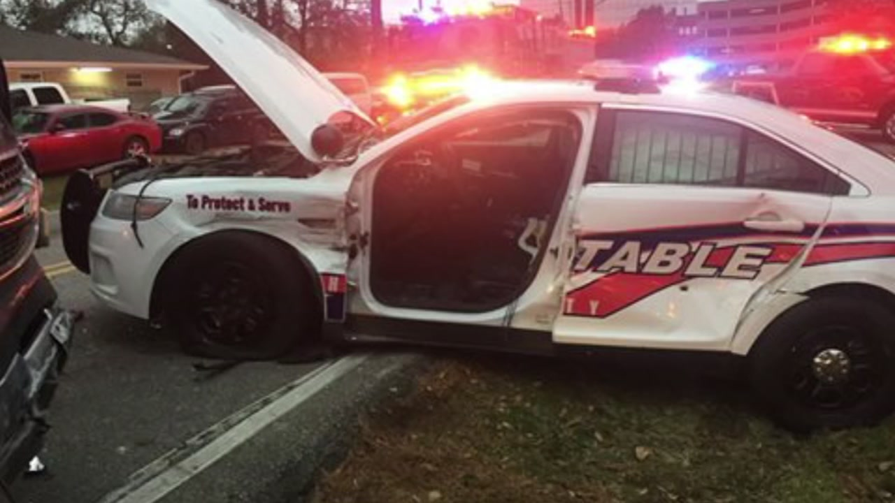 A constable deputy inside his patrol car was hit by a suspected drunk driver in northwest Harris County, authorities say.