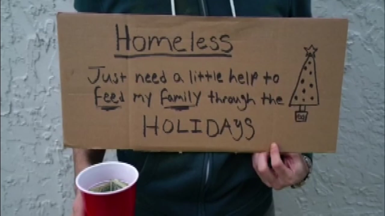 Man poses as homeless man, hands out money.