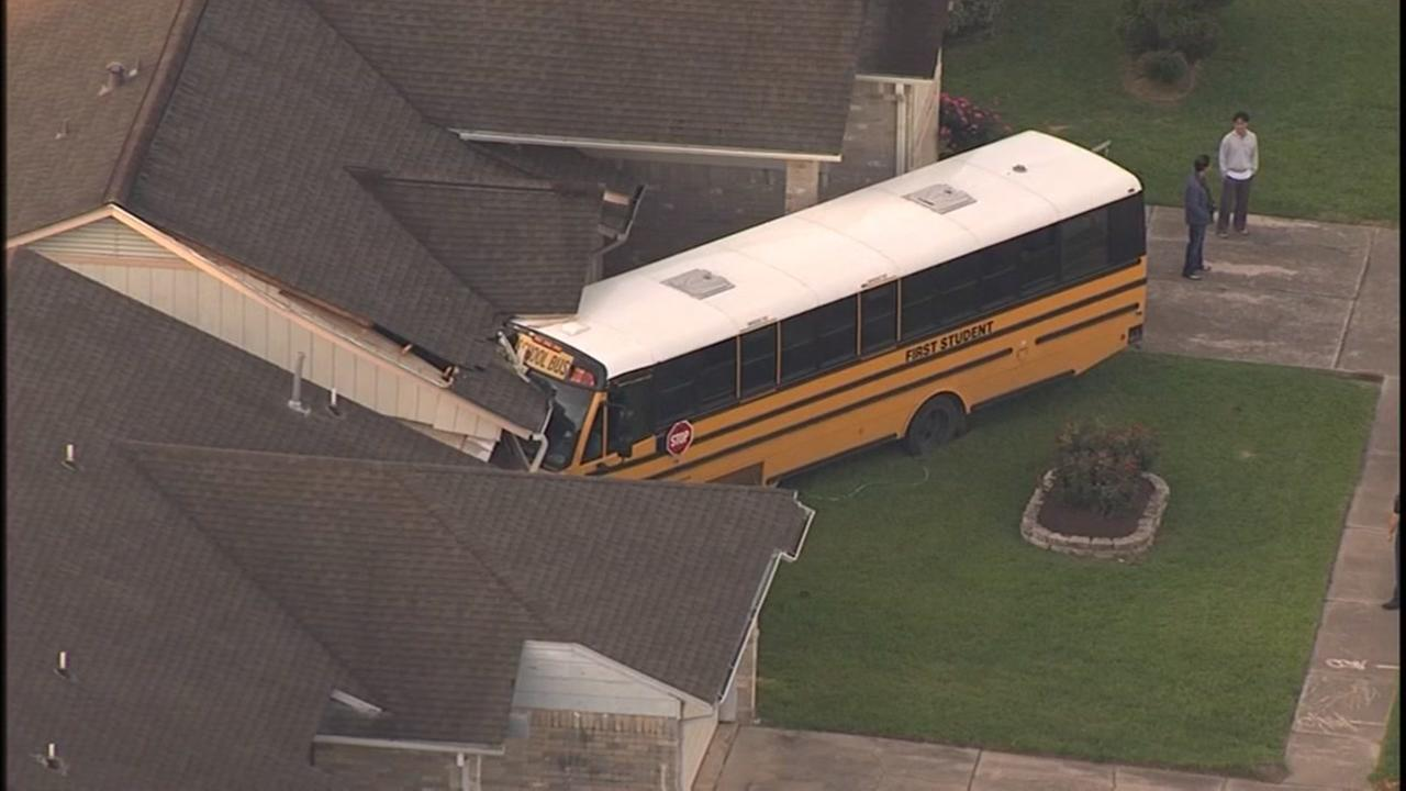 School bus crashes into house