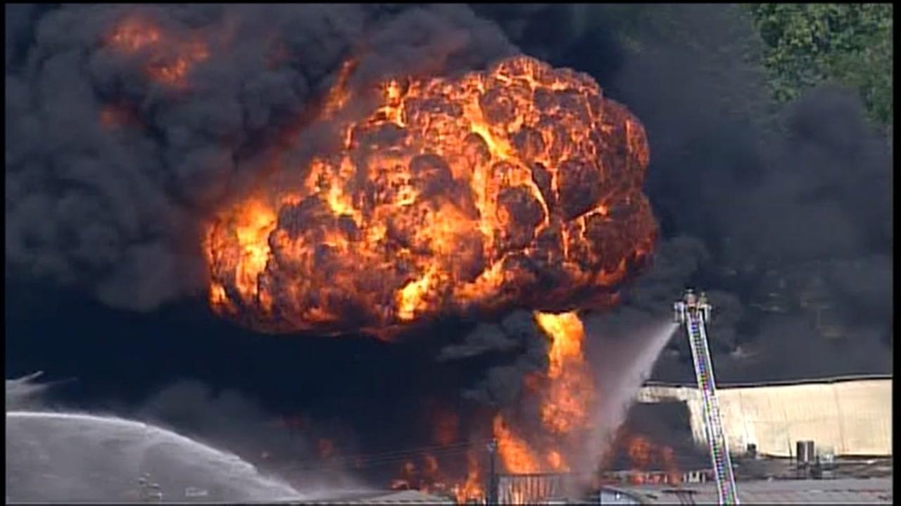 Huge warehouse fire sends fireballs into Houston sky