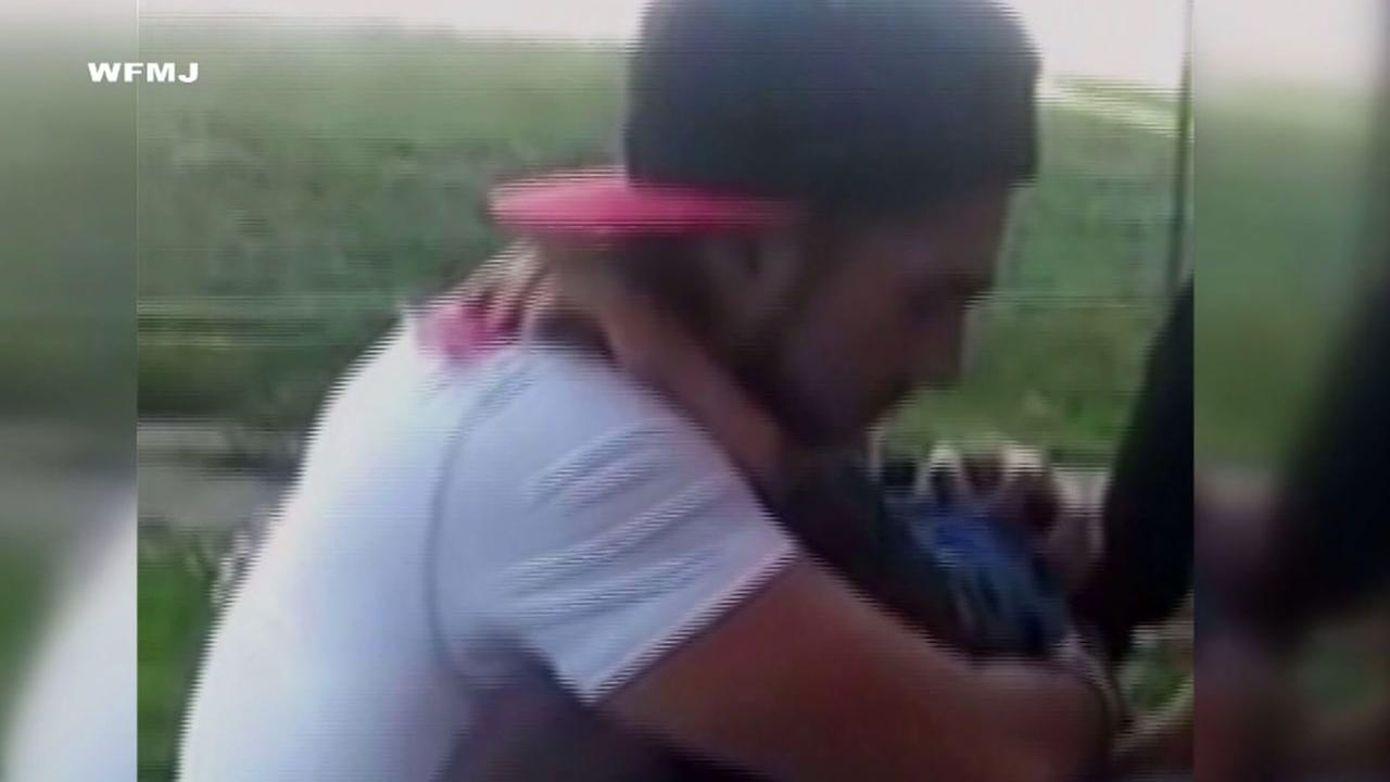 Father films moment he tells son his mother died of heroin overdose