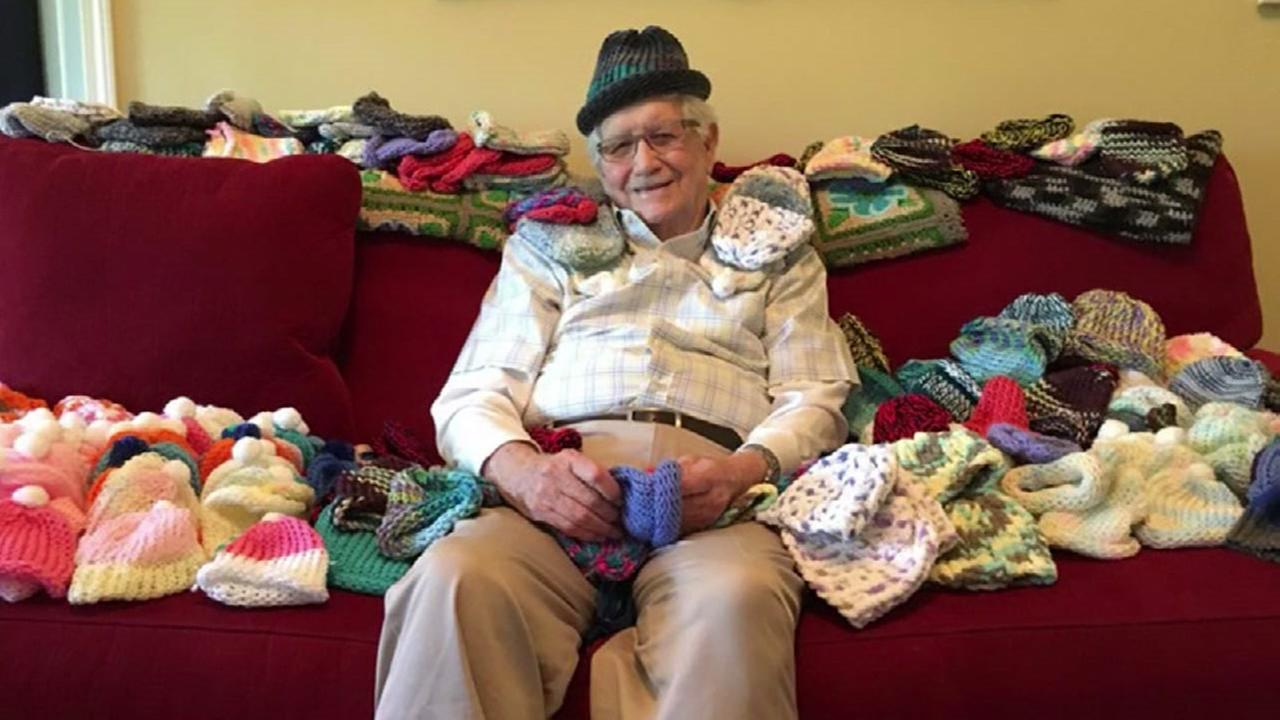 Elderly man learns to knit caps for babies