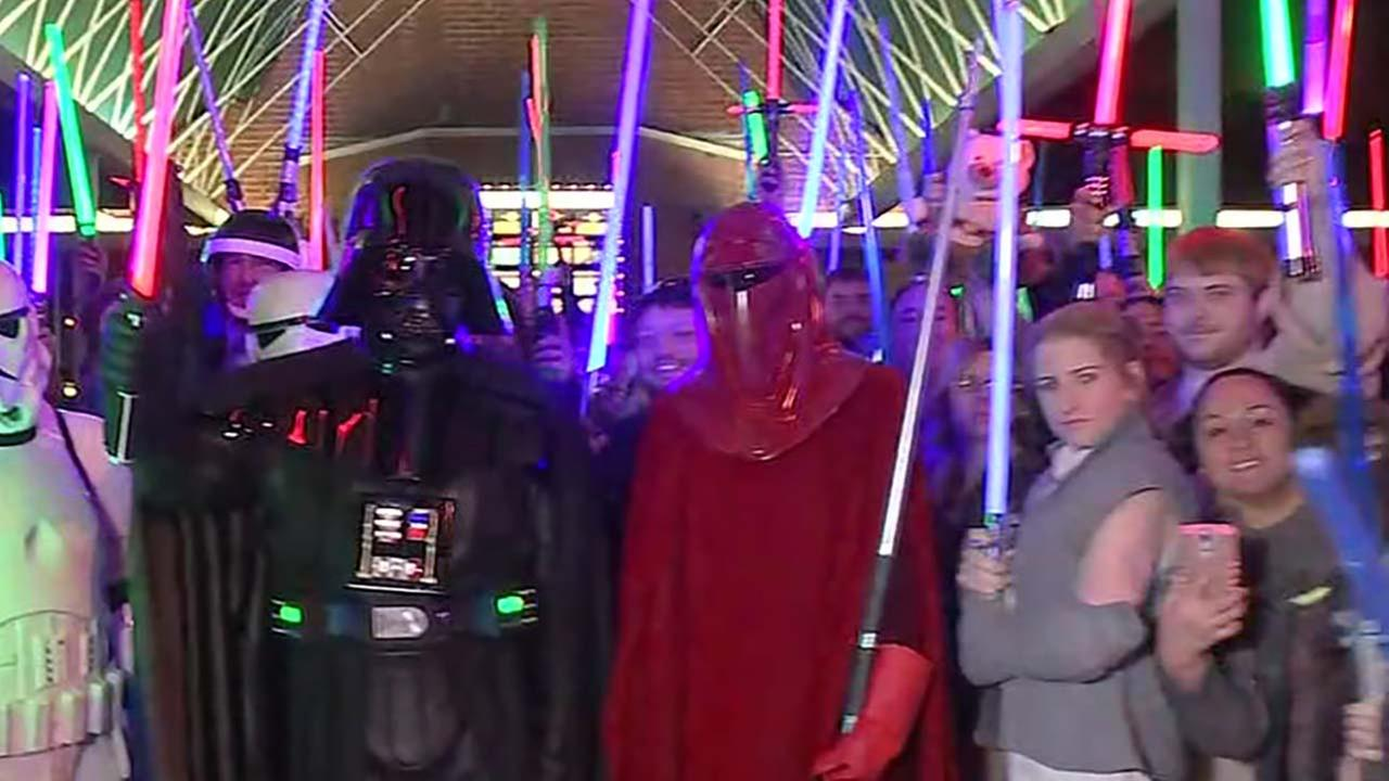 Fans hold lightsaber vigil for Carrie Fisher in Katy