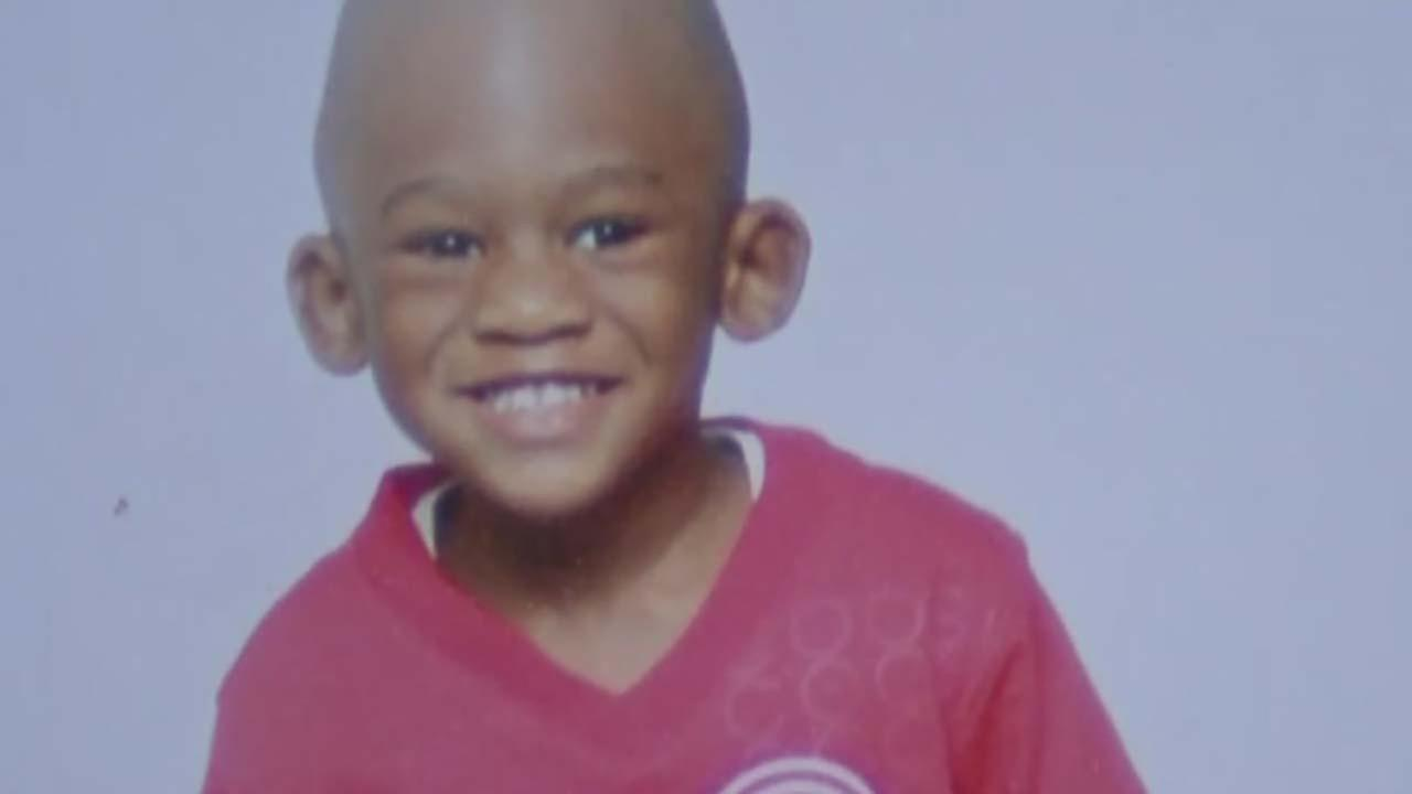 Boy sitting in morgue as family fights over burial