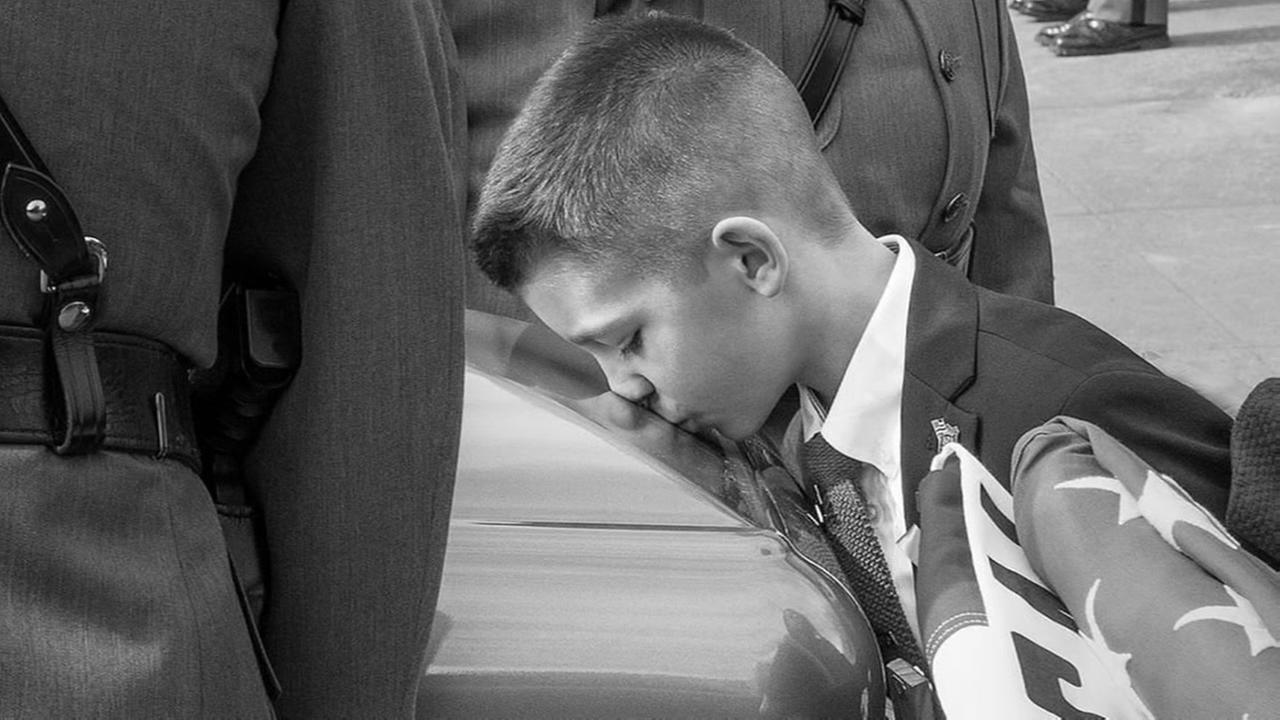 Photo of boy kissing fathers casket goes viral