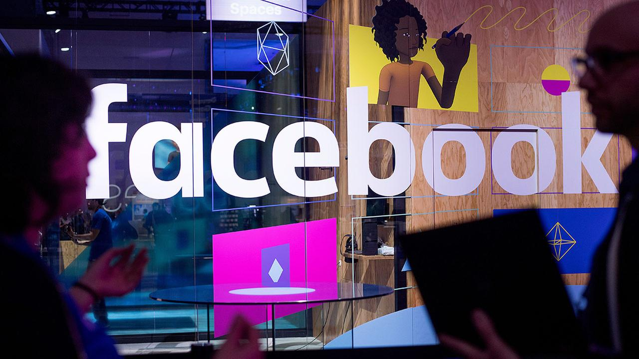 Conference workers speak in front of a demo booth at Facebooks annual F8 developer conference, Tuesday, April 18, 2017, in San Jose, Calif.