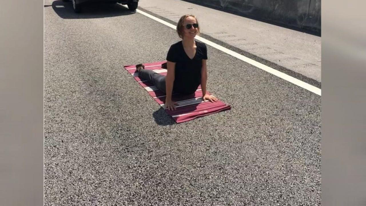 Woman turns traffic jam into Yoga session
