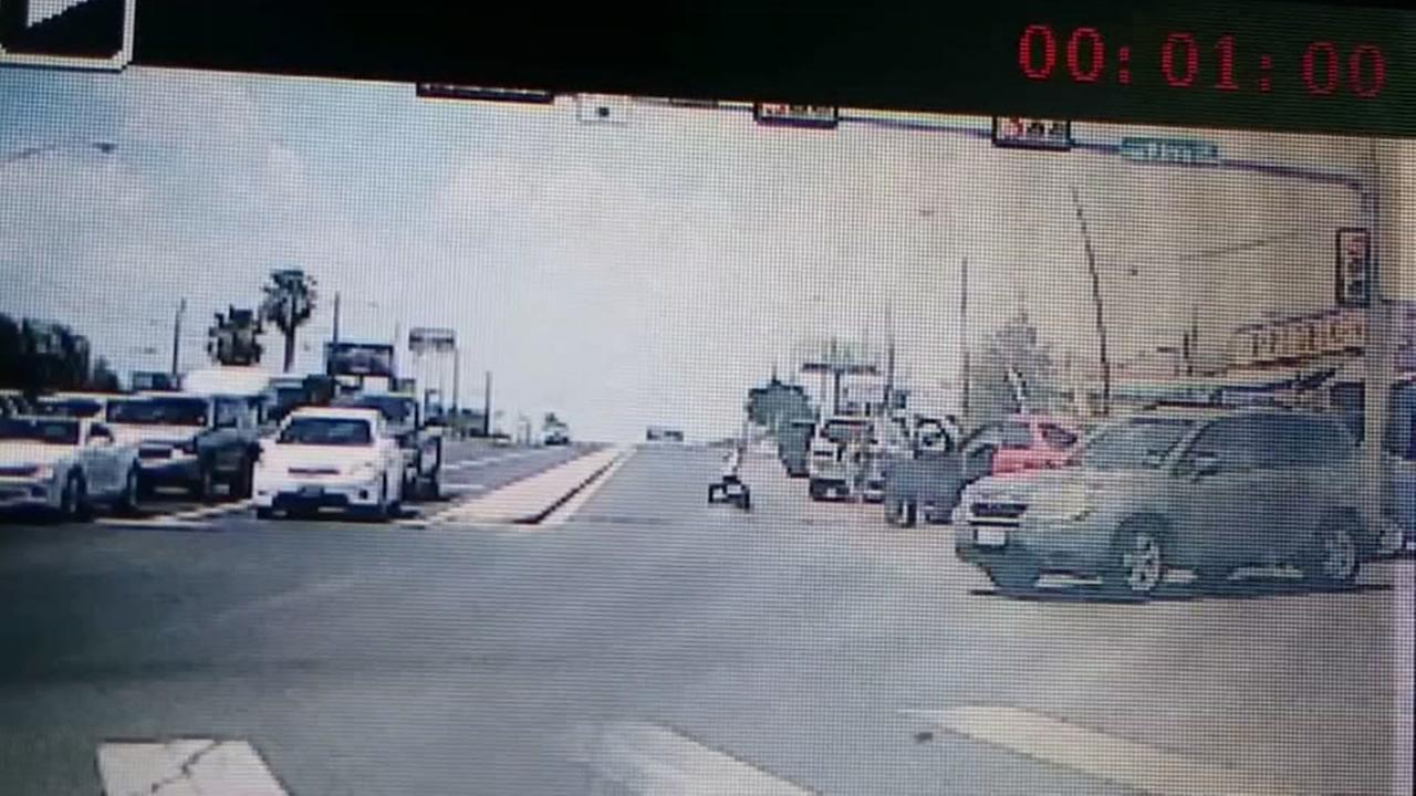 Caught on camera: Baby flies out of SUV onto roadway