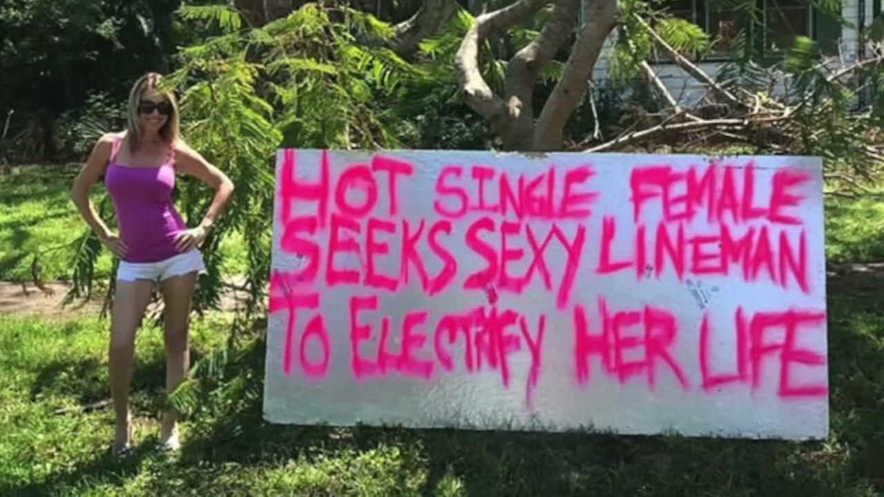 Florida woman made a sign to try and catch the attention of power crews
