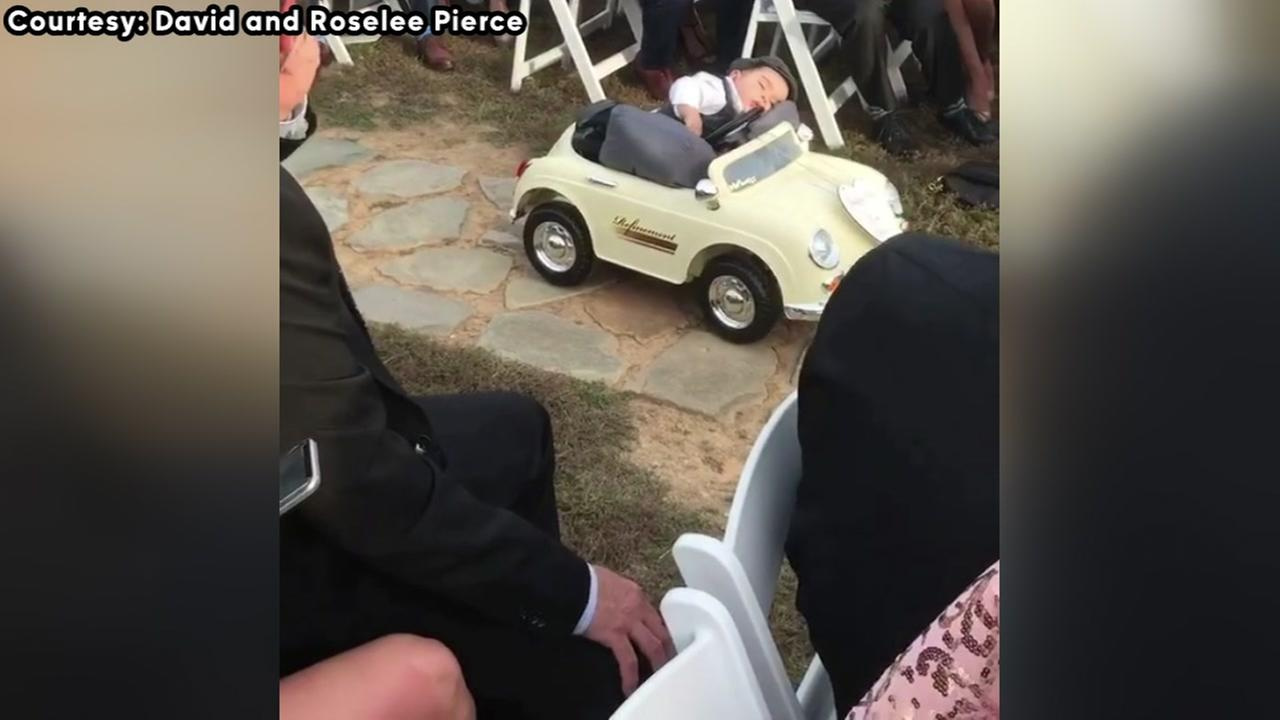 Milk drunk boy falls asleep on the job as ring bearer at parents wedding