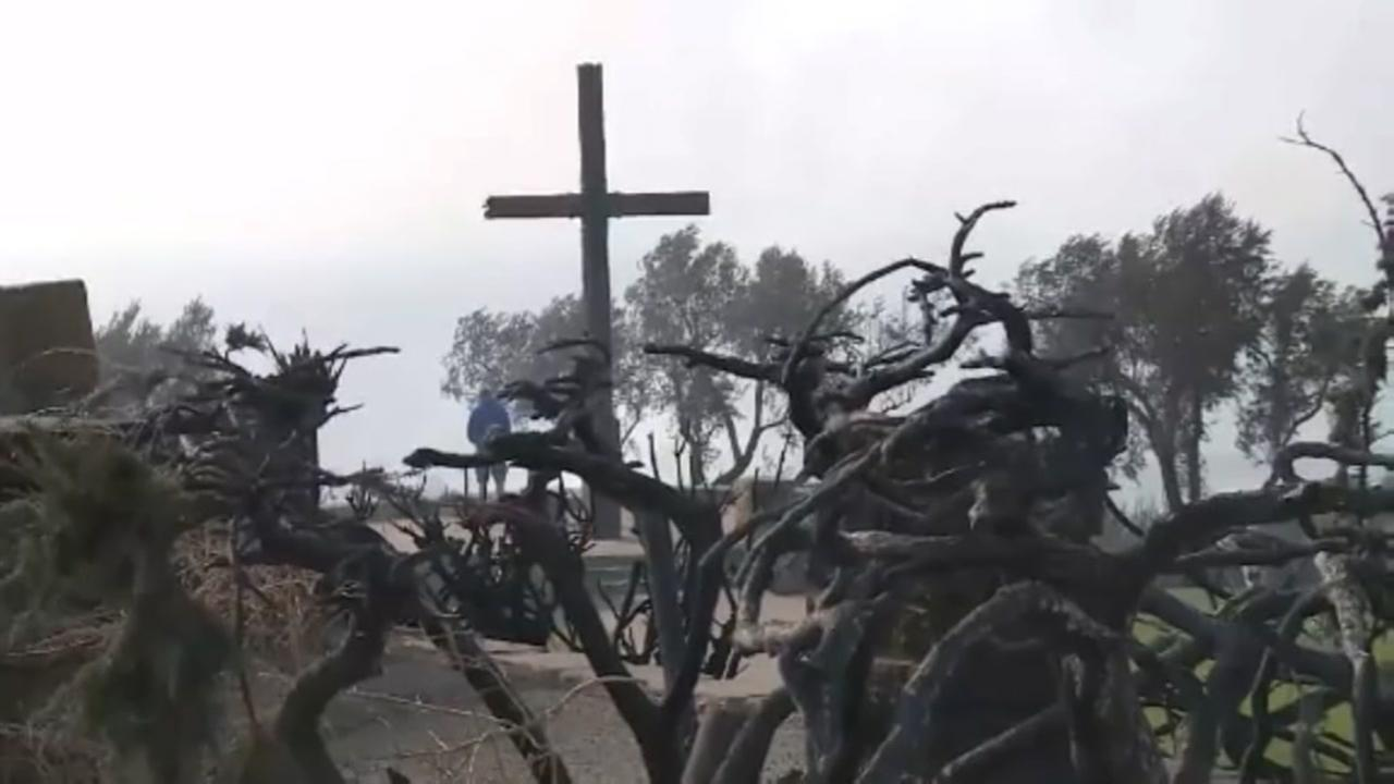 The iconic Serra Cross survives wildfire in California