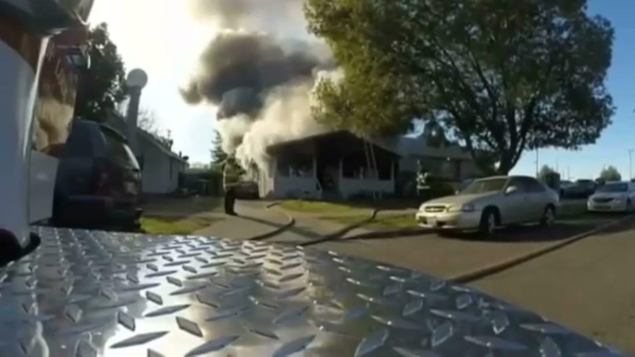 Delivery men save family from house fire