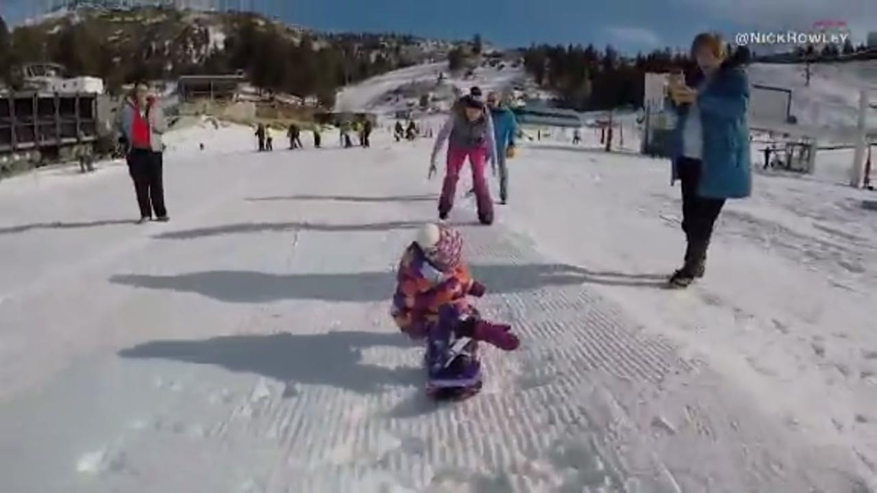 Toddler snowboards before first birthday