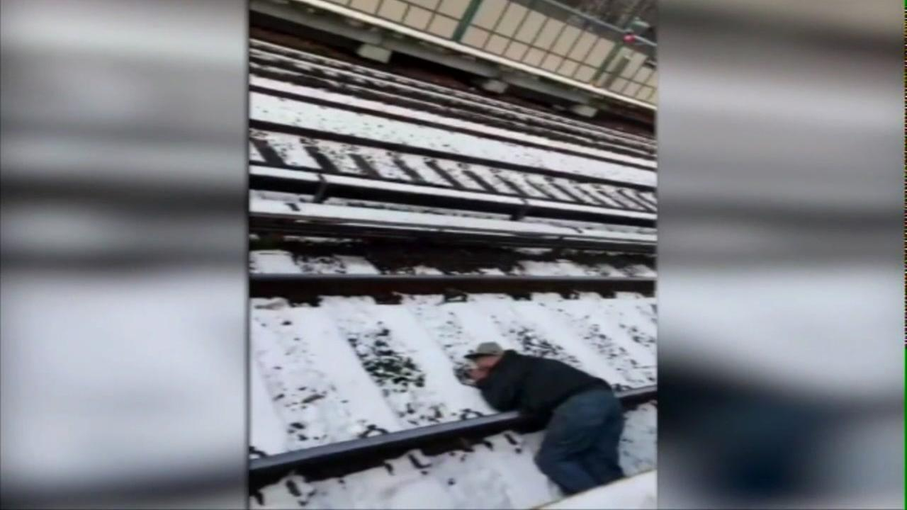Frantic video: Man rescued from subway tracks