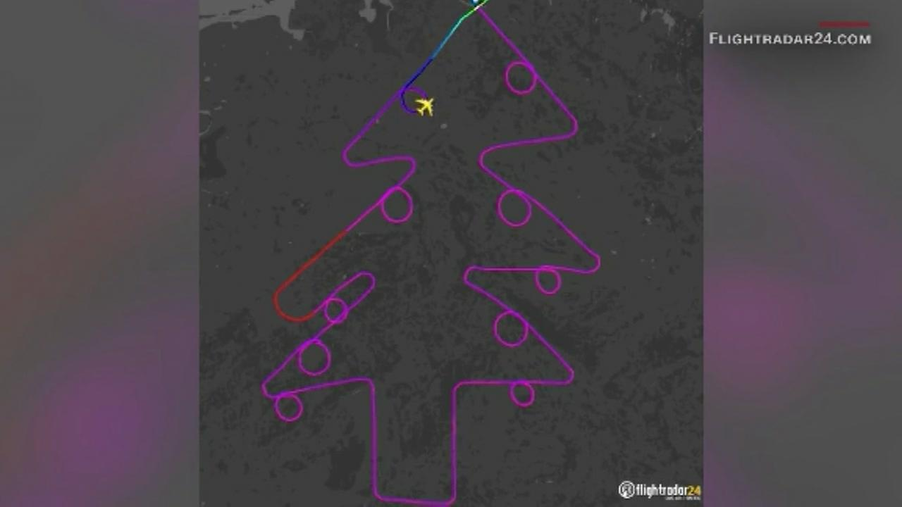 An airliner draws a Christmas tree with its flight path